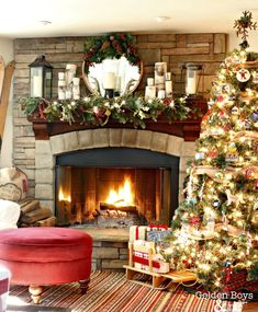 Rustic lodge style family room at Christmas with corner stone fireplace and vintage wood skis-www.goldenboysandme.com