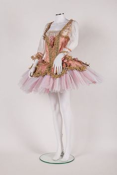 this is to honor Anna Pavlova on her birthday January 31st.... ; an embroidered gold and pink tutu worn by a Royal Ballet soloist dancer preformed at the Royal Opera House...