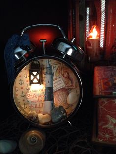 Altered Clock. Altered art, assemblage, nautical, lighthouse, nightlight.