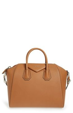 Free shipping and returns on Givenchy 'Medium Antigona' Sugar Leather Satchel at Nordstrom.com. Beloved by street-style mavens and well-polished women the world over, Givenchy's Antigona satchel is done here in richly dyed sugar leather, a softly pebbled goatskin that imparts subtle texture to this classic and versatile style.