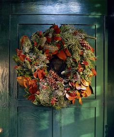The golden-brown hue of crisp Magnolia leaves in a wreath make a nice transition from fall to winter. We show you how to put this handsome find to work on your mantel by making a magnolia leaf garland here.