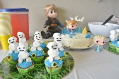 Ollivander's Disney Frozen Fever Birthday Party with snowgies by Brandais Markey, Anna Elsa handmade cake cupcakes kristoff Disney Animator Doll koolaid Funko