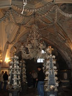 "The bone church is located in Kutna Hora, a few miles outside of Prague, in the Czech Republic. Officially called the Sedlec Ossuary, it is often just referred to as ""the bone church"" and contains over 40,000 bones arranged to decorate this Roman Catholic Church.    40,000 dead form morbidly fascinating sculptures and artwork; skeletons meticulously fashioned in 1870 by a wood carver. This is Sedlec's Church; All Saints ossuary in the Czech Republic Bohemia Pattern, Sedlec Ossuary, Cathedral Basilica, Church Interior, Catacombs, Roman Catholic, Oh The Places You'll Go, Czech Republic, Prague"