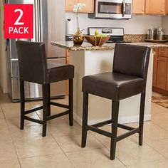 These comfortably soft, bonded leather bar stools are a perfect transitional piece from your kitchen to your living room. These bar stools feature brown-colored leather and espresso stained legs.