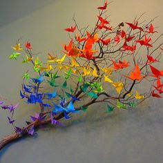 I did something very much like this in highschool art class, on a potted dead tree with all white cranes :)