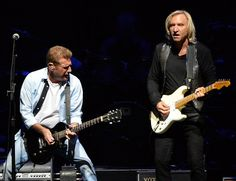 Joe Walsh Photos - Glen Frey and Joe Walsh of the Eagles perform during 'History of the Eagles Live in Concert' at the Bridgestone Arena on October 2013 in Nashville, Tennessee. - History of the Eagles Live in Concert Eagles Lyrics, Eagles Band, Soul Music, My Music, Eagles Albums, History Of The Eagles, Eagles Live, Glen Frey, Comedy Acts