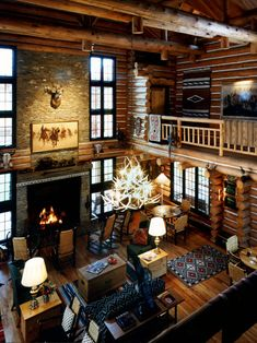 cozy hunting lodge-style log cabin with loft, exposed beaming, gorgeous antler chandelier...