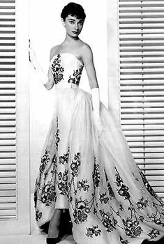 Sabrina!...Givenchy creation, as was this exquisite evening gown, which our heroine wears in the tennis court/Isn't It Romantic scene with David (William Holden).