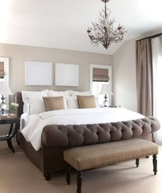 relaxing master bedroom with elegant chandelier, tufted upholstered bed and bedroom bench