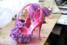 . purple decorated shoes .