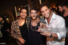 Actors Tyler Posey, Cody Christian, and Diego Boneta attend the annual Midsummer Night's Dream party hosted by Hugh Hefner at The Playboy Mansion on August 27, 2016 in Los Angeles, California.