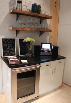 loving: the wood, balanced chalkboards, and general cuteness of this kitchen nook.
