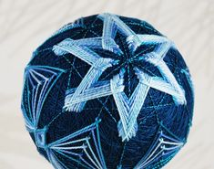 Add support lines to help  place stitches at the outside points.    Update - last night I stitched a new temari with this unusual techniqu...