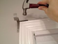 Kwikhang curtain rod holders. No holes/drilling required!