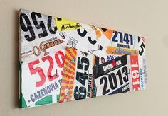I love this idea for bib numbers from races & competitions. I would include ribbons as well. They added hooks for medals in the middle. I might give up some hanging space and hang the medals form the bottom.