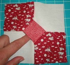 tutorial  --  3-Dimensional Bow-Tie.  I learned this years ago on TV, it makes a cute (quick!) baby quilt, too!