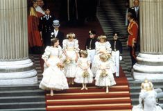 The bridesmaids and pages are Lady Sarah Armstrong Jones, 17, Edward Van Cutsem, 8, Lord Nicholas Windsor, 7, India Hicks, 13, Sarah Jane Gaselee, 11, Catherine Cameron, 6 and Clementine Hambro, 5.