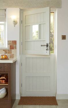 Another style of stable door. This one won't fit, and can't be altered due to design. Discover the extensive range of doors at Howdens. Available in a variety of styles and finishes to suit any property. In stock at over 700 depots nationwide. External Doors, Interior Barn Doors, Cottage Chic, Cottage Style Doors, Cottage Front Doors, Cottage Windows, Country Kitchen, Dutch Kitchen, Windows And Doors