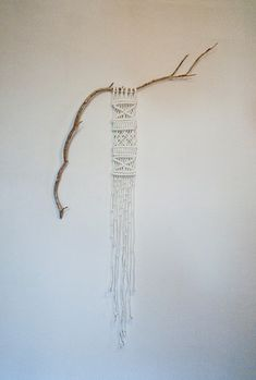 Beautifully simple Macrame wall hanging natural look.