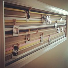Great idea for a little story / photo board in your home - this is made from a natural coloured thick card in a white frame - then loads of different ribbons are fixed across the length of the board. You can then peg your photos for a quirky alternative.