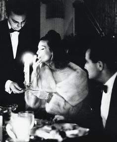 Model Mary Jane Russell dining with her husband Ed Russell, 1950s.
