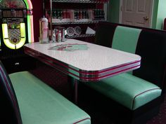 Our deco diner booth set has two diner booth benches done in your choice of colors. Also includes table and base custom built to your color.