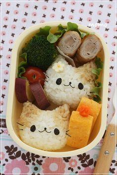 Adorable kitty cat onigiri bento (made from rice, soy sauce, & nori)