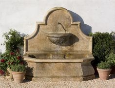 Don't fret over an empty wall in the garden, the Andalusia Fountain will occupy the space!