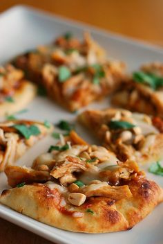 Thai-style Chicken Flatbread - delicious appeitzer or dinner! Chicken with a peanut sauce on naan bread!