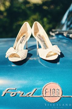 Wedding shoes on vintage blue Ford truck