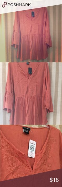 Price Cut! Burnt Orange Torrid Shirt Beautiful, brand new (never worn) shirt from Torrid with tags still on! Plus size 1. It doesn't fit me and fits more like a regular XL on me. It's nice and flowy. Burnt orange color. Torrid Tops Blouses