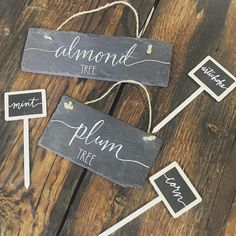 Hand calligraphed garden signs we made for our green thumbed client!