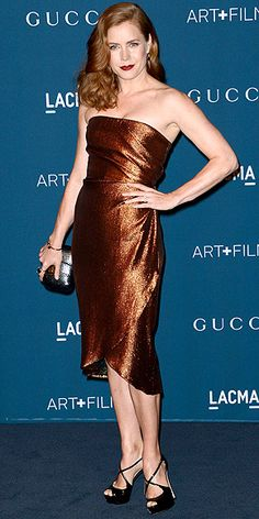 AMY ADAMS Are dresses that match your hair color going to be the next big trend? Amy seems to think so, choosing a copper strapless knee-length Gucci design, plus strappy black heels for the LACMA party.