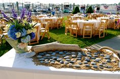 River rock place cards and seating assignments for our rehearsal dinner