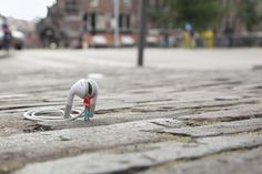 "Background Noise by Slinkachu. From the series ""A tiny street art project: little hand-painted people, left in London to fend for themselves""."