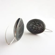oxidized sterling jewelry pieces are by French artist Mathilde Quinchez