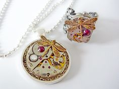 A matching set with vintage watch movements and swarovski crystals - happy to custom make with different colours and charms