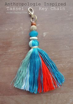 DIY Tassel Keychain - love this craft how to for a colorful boho chic beaded tassel inspired by Anthropologie! Complete step by step instructions with lots of step photos showing how to make the tassel and attach it to a keychain. Would be cute as a purse embellishment, too. Great craft party idea for a girls' night -- what a fun hack!
