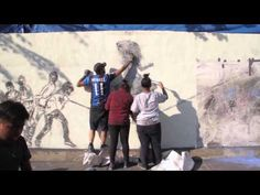 Andrea Mastrovito, KICKSTARTING, 2014 - YouTube Summary from the Drawing Center Website   Kickstarting is a project based on the interaction between sports and art. Using soccer balls and tempera powder, Andrea Mastrovito together with one hundred children from Bushwick, Brooklyn created a gigantic mural by kicking the soccer balls against the wall to inscribe marks, giving new life to the courtyard of Saint Joseph Patron Parish in Bushwick.
