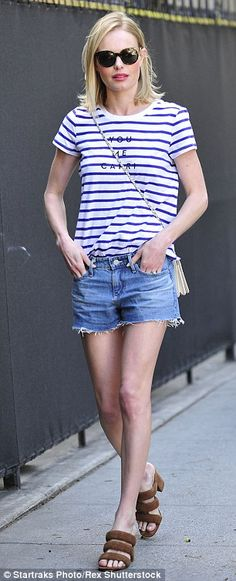 European vibes: The blonde beauty wore a striped shirt with 'YOU ME CAPRI' written across the front