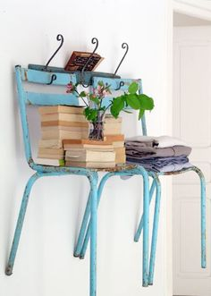 Also a cool idea for shelving, although I think I would use kid chairs because I tend to be a little clumsy. I've also seen chairs cut in half vertically and put with the cut side against the wall.