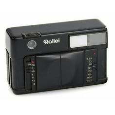 """This Rollei was sold November 19th, 2016 by Westlich Photographica Auctions for 3,000 Euros. It's details say """"Rollei 35 Design Model c.1980"""" it's black and made of wood supposedly. Never made it to production!"""