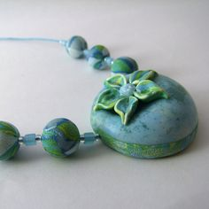 Green and turquoise marble effect polymer clay flower pendant necklace by Cate van Alphen (Fulgorine)