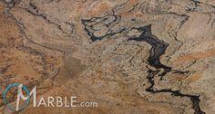 Kitchen - Granite - Peregrine C      A popular light gold granite with busy black swirls that break up the calmness.  Granite: 152/932