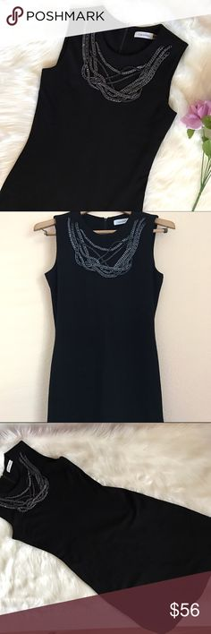 """Calvin Klein """"Little black chain neck dress"""" ❤️ Excellent condition, no sign of wear. Size 2. Dry clean only. 72% Rayon 24% Nylon 4% Spandex. Armpit to armpit 16"""" Armpit down 30.5"""" Shoulders down 38"""" Calvin Klein Dresses"""