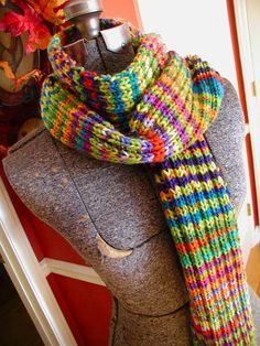 """A k2, p2 changing yarn every two rows-one skein each of Hobby Lobby's """"I Love This Yarn"""" in Candy Corn Ombre, and Jazz Stripes."""