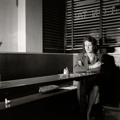 April 1943. Washington, D.C. 'Girl sitting alone in the Sea Grill waiting for a pickup'