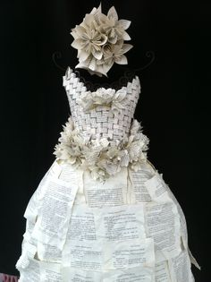 """I want to put this in cool things being done my educators...but it really goes here.  This upcycled wedding dress was designed, woven, and sewn by students in Lori Llerandi's art class at Louisville Middle School in Colorado. Discarded library books were used for the """"fabric."""""""