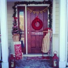 Christmas front porch. I love the red lanterns and white crates.
