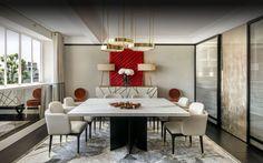 Delightful marble top dining table and enchanting dining armchairs. Lovely modern wool rug.